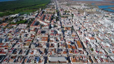 architecture and urbanism : Aerial. View from the sky of village of Vili Real Santo Antonio and the Guadiana River. Stock Footage