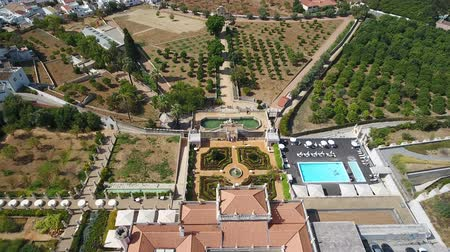 avlu : Aerial. 2 Setember 2017- Portugal Estoi Flying a drone over a historic castle in the village.