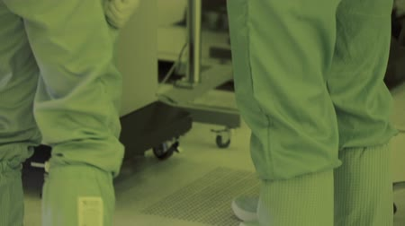 automated : leg foot in a sterile suit. panorama camera. nano microchip production technology. microprocessor. sterile atmosphere clean zone. high-tech production.