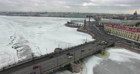 harbor bridge : Aerial view. Flying along the river in winter overcast cold weather. Bridge over the river Petersburg. The height of the birds flight over the frozen river.