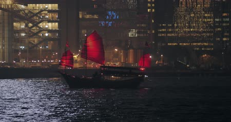 барахло : Traditional wooden junk boat with red sails in Hong Kong at night