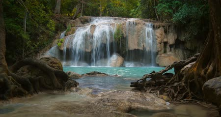 cena de tranquilidade : Idyllic peaceful background of beautiful waterfall cascade in Erawan national park in Thailand. Exotic tropical paradise landscape