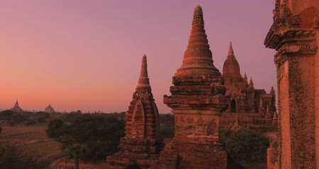 határkő : Travel landmark of Myanmar Burma - Bagan historical site with many Buddhist temples and pagodas at sunset. Famous travel destination