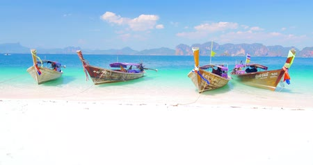 Пхукет : Exotic tropical beach with tourist wooden boats on sea coast at sunny summer day near Phuket island and Krabi province. Famous travel destination Стоковые видеозаписи