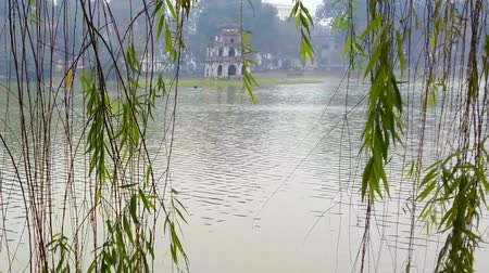 north vietnam : Turtle Tower or Thap Rua tower on Hoan Kiem lake, Hanoi, Vietnam. Famous tourist travel landmark in old district of Hanoi Stock Footage