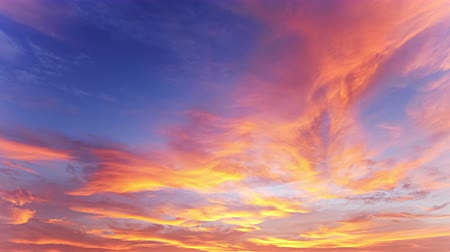 gorgeous : Beautiful sunset time lapse background. Clouds of yellow and golden orange color moving and changing fast at evening dawn