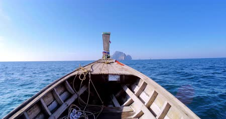 ryba : Wooden fishing boat moves on sea at clean sunny day with blue sky Dostupné videozáznamy