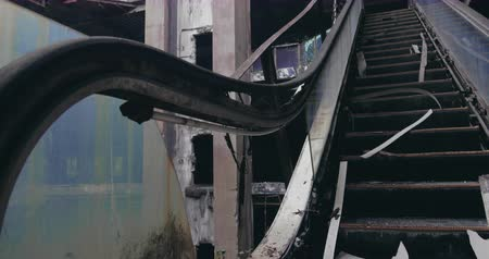 abandoned old : Slider shot of destroyed escalator in demolished building. Disaster scene