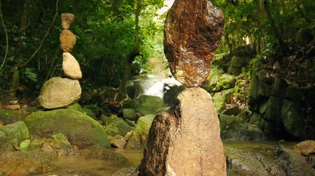 релаксация : Zen meditation and relaxation nature background of rock towers in tropical garden