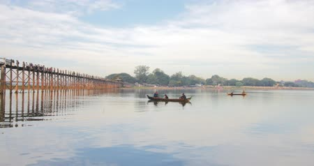 u boats : Fishermen on wooden fishing boats at morning near U-Bein bridge in Amarapura region Stock Footage