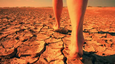 psikoloji : Barefoot woman walks through surreal desert land landscape. Autistic depressed and emotional scene of human psychological problems