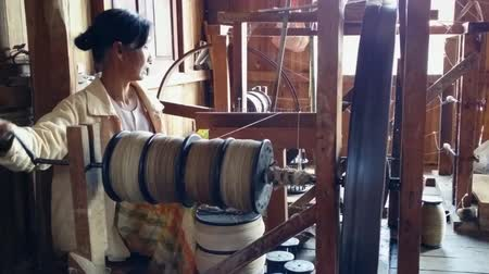 zanaat : Southeast ethnic craft village. Local woman in textile factory. HD video footage