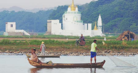 u boats : Fishermen and local villagers on daily routines on riverside near ancient Pagoda Stock Footage