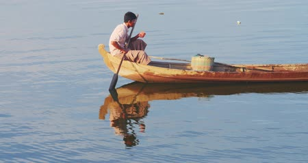 u boats : Burmese fisherman fishing on traditional wooden boat