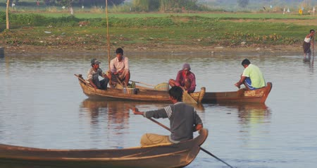 u boats : Burmese fishermen on traditional wooden fishing boats near U Bein bridge in northern Myanmar. Rural countryside scene