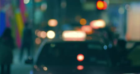 運輸 : Blurred off focus background of city street at night with passenger entering in taxi cab