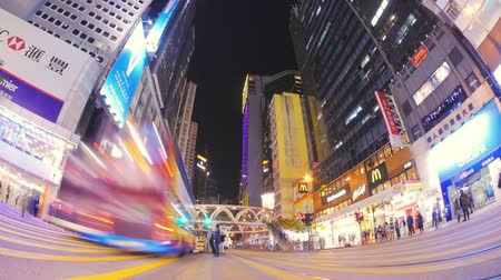 rua : Night time time lapse video of busy crosswalk in downtown of Hongkong city with unidentified people crossing street and cars moving fast