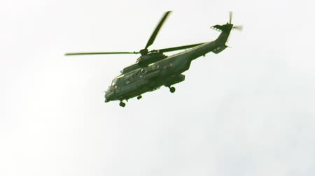 katonai : Military Army helicopter flying in air against sky