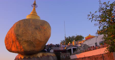 paya : Local tourists and travelers paying respect to ancient Buddhist relic Golden Rock