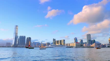 beach panorama : Modern city skyline of Hong Kong from Victoria harbor with boats passing in port