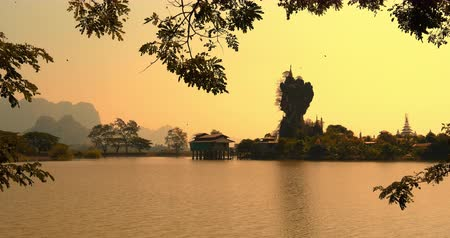 local de culto : Buddhist monastery in Hpa An, Myanmar Burma at golden sunset