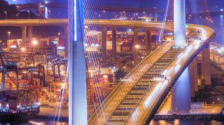 nowoczesne : Blurred car lights moving at night on modern Stonecutters bridge in Hong Kong