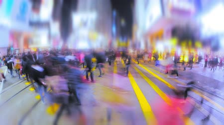 hong kong foot : Seamless looping video with blur effect of anonymous people cross night street