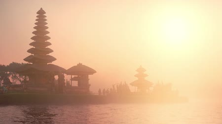 bratan : Balinese Pura Ulun Danu Bratan at sunset lit with warm yellow sunlight Stock Footage