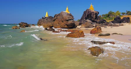 szentelt : Buddhist stupa on rock on Ngwe Saung beach in Myanmar. Burma travel destinations