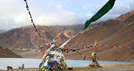 prayer flag : Buddhist religious pagoda and prayer flags against Himalaya mountains and Chandra Tall sacred lake. Travel destination and tourist landmark in India