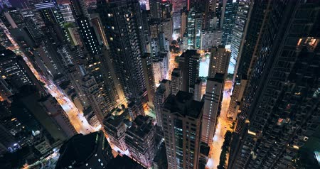 Aerial view of modern city at night. Architecture exterior of asian metropolis Hong Kong