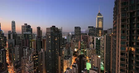 perspective : Hong Kong skyline at sunset. Modern city urban architecture cityscape panorama