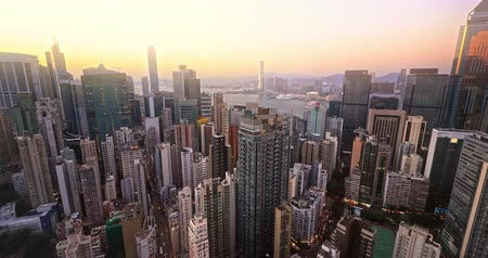 Hong Kong harbor view at sunset. Panoramic skyline cityscape aerial landscape