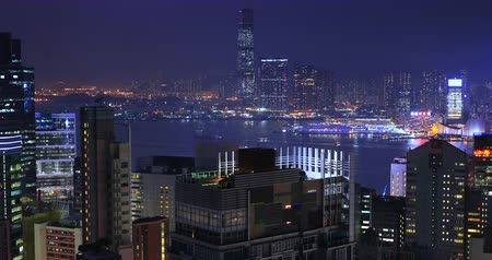 Urban night city skyline. Modern Asia metropolis downtown architecture near Victoria Harbour in Hong Kong