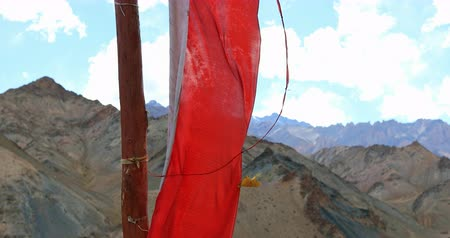 bhutan : Red Buddhist flag against Himalaya mountains in Ladakh, North India. Visiting religious places in remote areas of the country