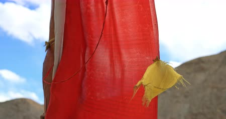 bhutan : Buddhist prayer flag moves on wind breeze with mountains on background. Buddhism in north India as dominated religion concept video background