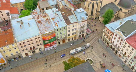 архитектурный : Lviv city Ukraine. Old center with houses and architecture, people and transport view from town hall Стоковые видеозаписи