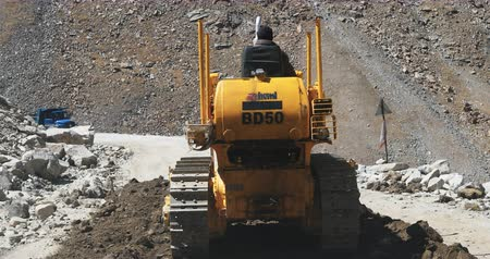 landslide : Road construction in north India, Himalayas. Heavy excavator repairs damaged road