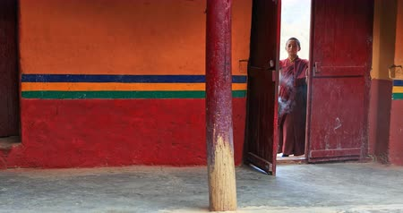 gompa : Novice Buddhist monk fuming with smoke Lamayuru monastery entrance as part of traditional and mystical performance Stock Footage
