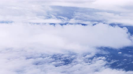 High altitude view of cloudscape with calm motion of white clouds
