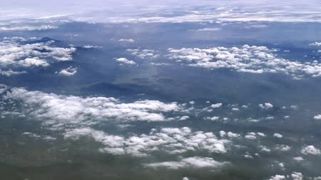 Panoramic aerial view of ground surface and uneven terrain of South Thailand as seen from airplane