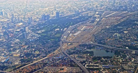 Mo Chit bus terminal in Bangkok aerial view. Flying above new MTR line construction district in capital of Thailand