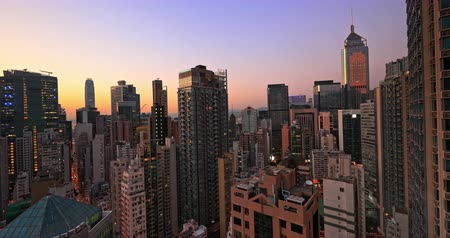 Sunset skyline and aerial cityscape of Hong Kong downtown. Urban architecture and modern skyscrapers scenic view