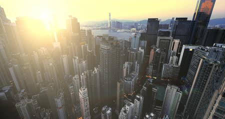 Sunset sun over Hong Kong skyscrapers aerial panoramic view. Beautiful urban city architecture background 影像素材