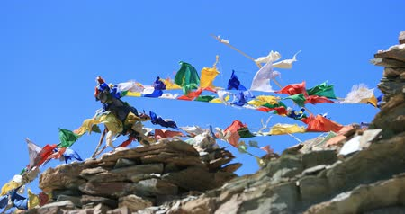 mantra : Travel to Himalaya mountains. Buddhist prayer flags move on wind against blue sky. Ladakh, India travel destinations