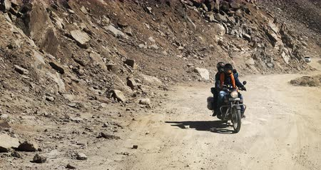 Extreme journey background. Bikers on motorcycle travel by offroad way in mountain landscape of Himalaya mountains
