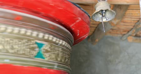 Big decorated prayer wheel spinning in Buddhist temple in Himalaya. Beautiful culture and traditions of northern India video background