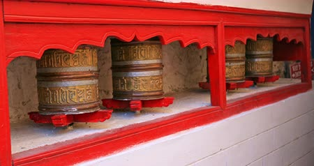 bhutan : Northern India and Asia traditional religion culture video background. Spinning Prayer Wheels in ancient temple