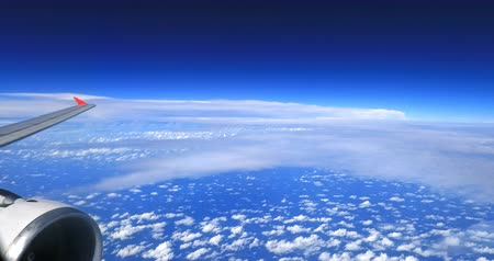 Scenic cloudscape aerial view from above. Traveling by airplane and looking through window beautiful background Stok Video