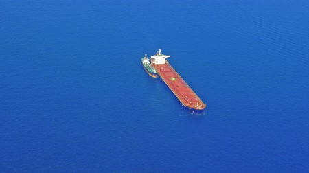 Cargo tanker ship in open sea aerial top view